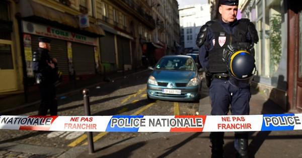 Paris police shoot armed man dead on first anniversary of Charlie Hebdo attacks