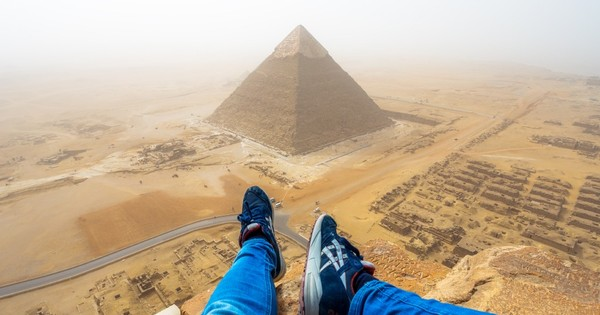 Watch this tourist (illegally) clamber up Egypt's Grand Pyramid for a breathtaking view