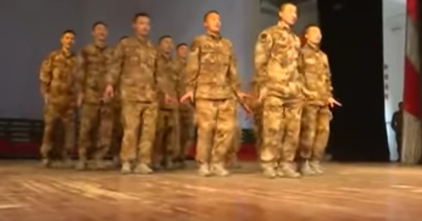 Watch Chinese men in uniform perform the (rather odd) 'chicken dance' to celebrate New Year