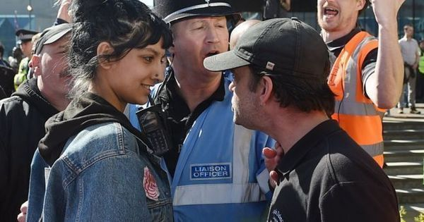 Watch: This is the woman who showed how to stand up to authority with a smile during protests