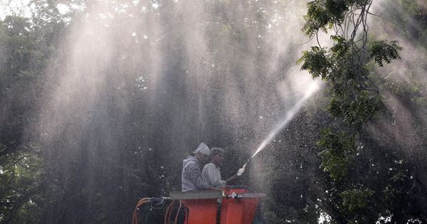 Delhi government wants to reduce air pollution by spraying water from helicopters. Is it feasible?