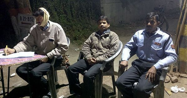 'Our work is out here': Delhi's night guards are outdoors when the air is most toxic