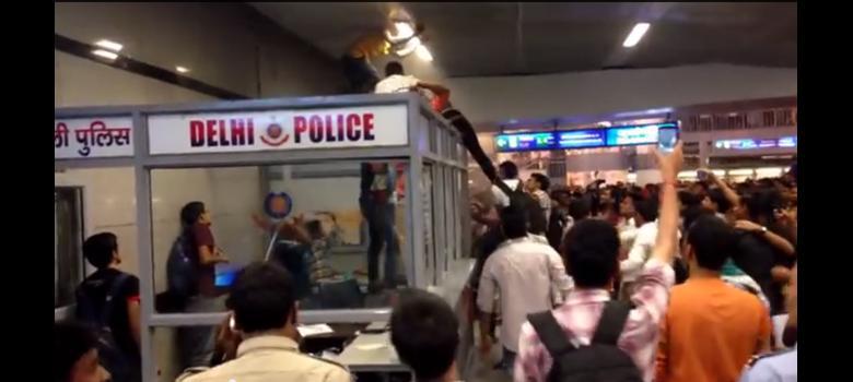 [Video] Cops look on as mob attacks black men in Delhi metro station