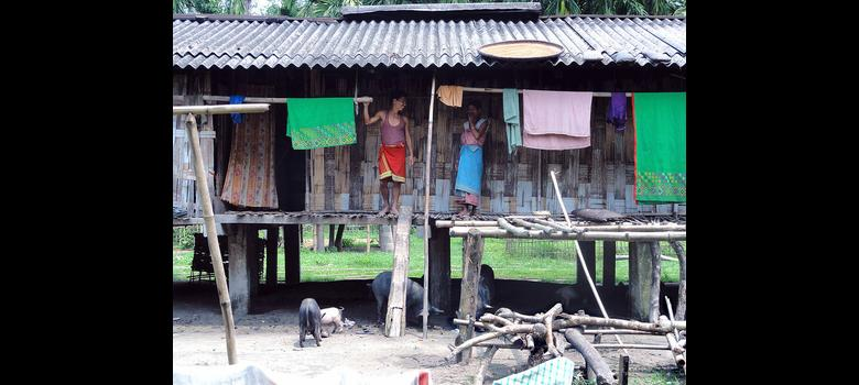 Hit by climate change, Assam river communities bury their pride, move into houses on stilts