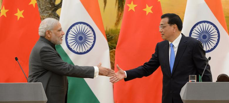 Two charts that explain why China playing around with the yuan should worry India