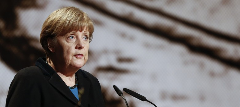 Mob abusing refugees repulsive and unjustifiable, says Angela Merkel