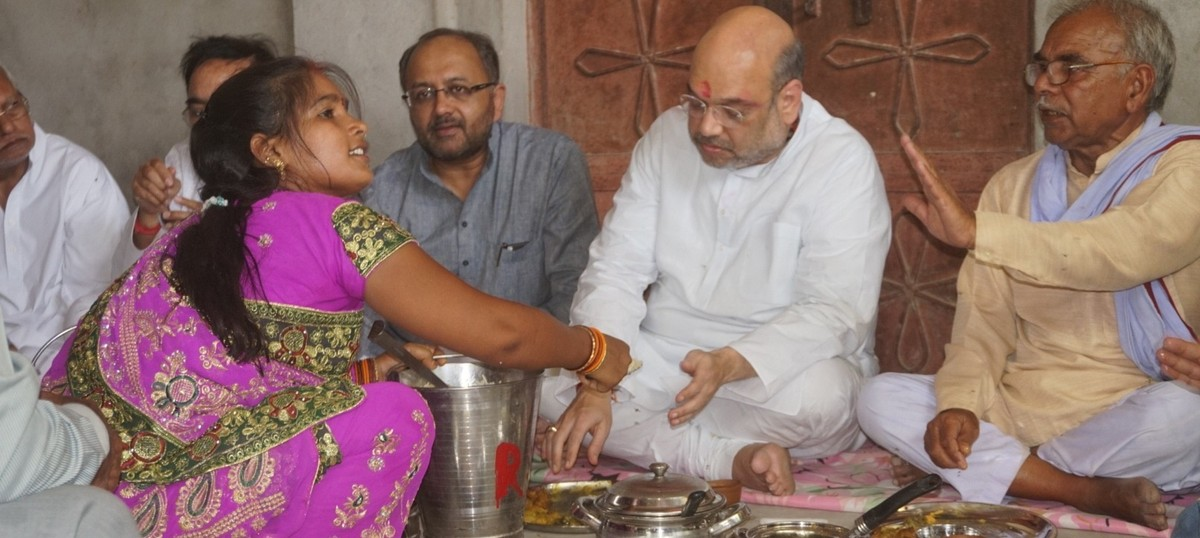 Amit Shah goes to lunch: Breaking bread with Dalit voters is now a popular political gesture in UP