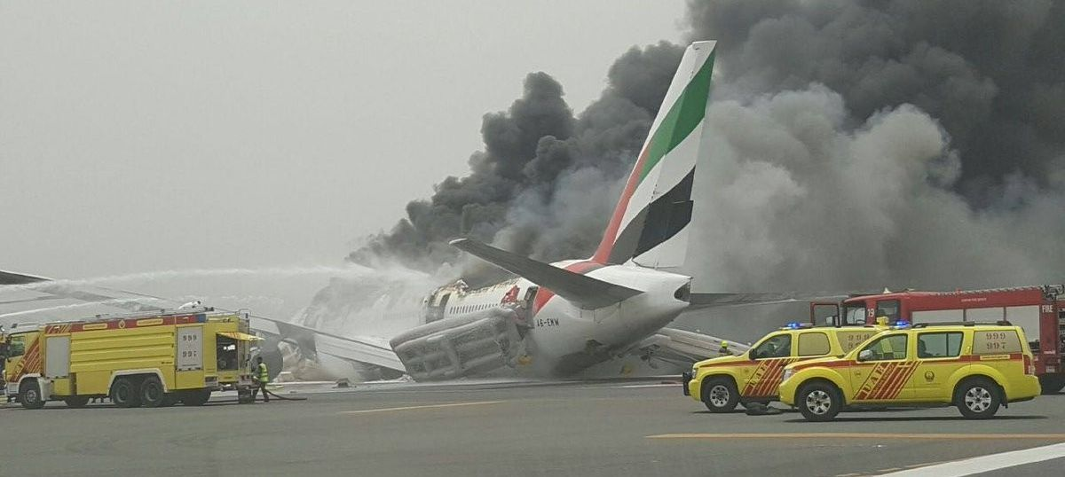 Why were Emirates passengers looking for their bags instead of getting out of the burning plane?