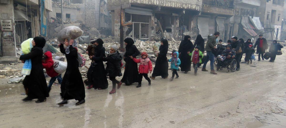 Gunfire erupts in Aleppo before the evacuation of civilians can begin