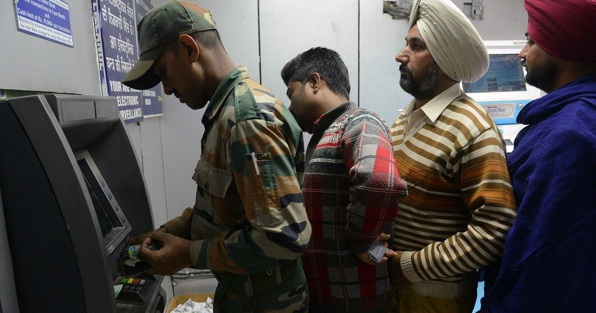 While soldiers stood on the border, their families stood in long lines outside ATMs and banks
