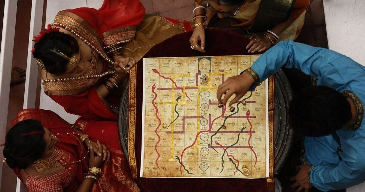 Indians are reviving an ancient version of Snakes and Ladders, in which winning isn't the point