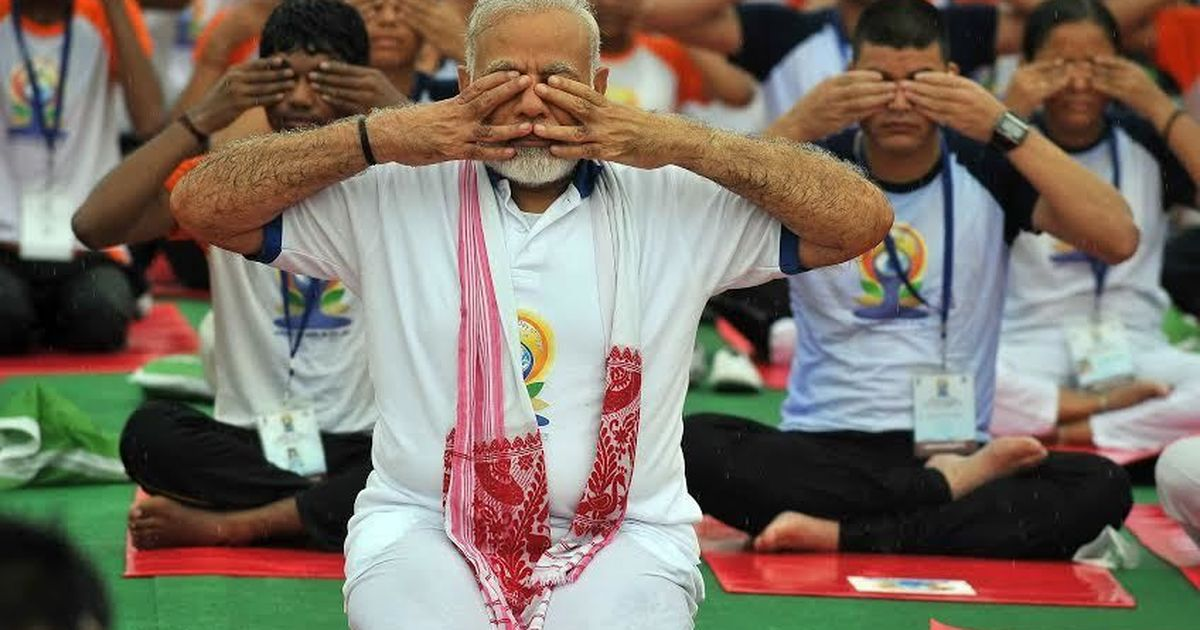 In photos: Thousands around the world strike a pose on International Yoga Day