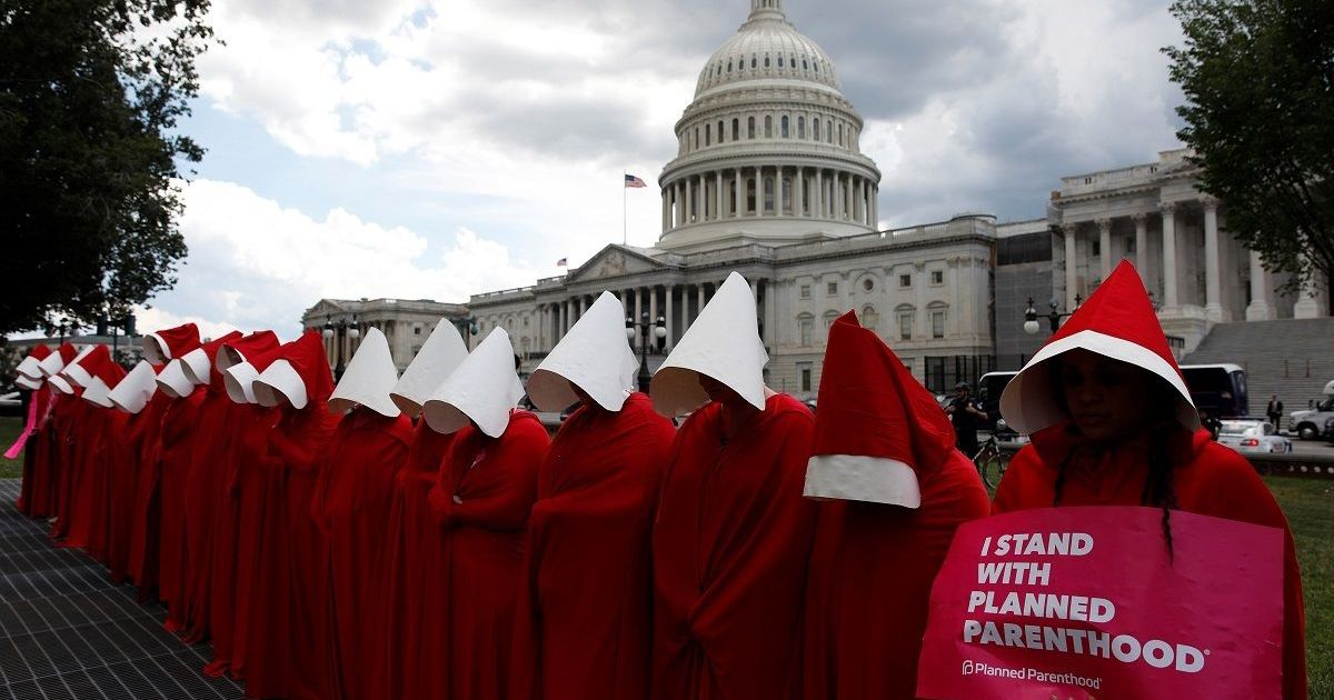 Why American women are dressing up in attire from Margaret Atwood's 'The Handmaids Tale'