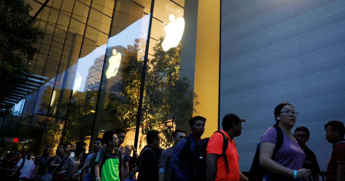 Why do so many people queue up for hours at Apple stores when a new iPhone is launched?