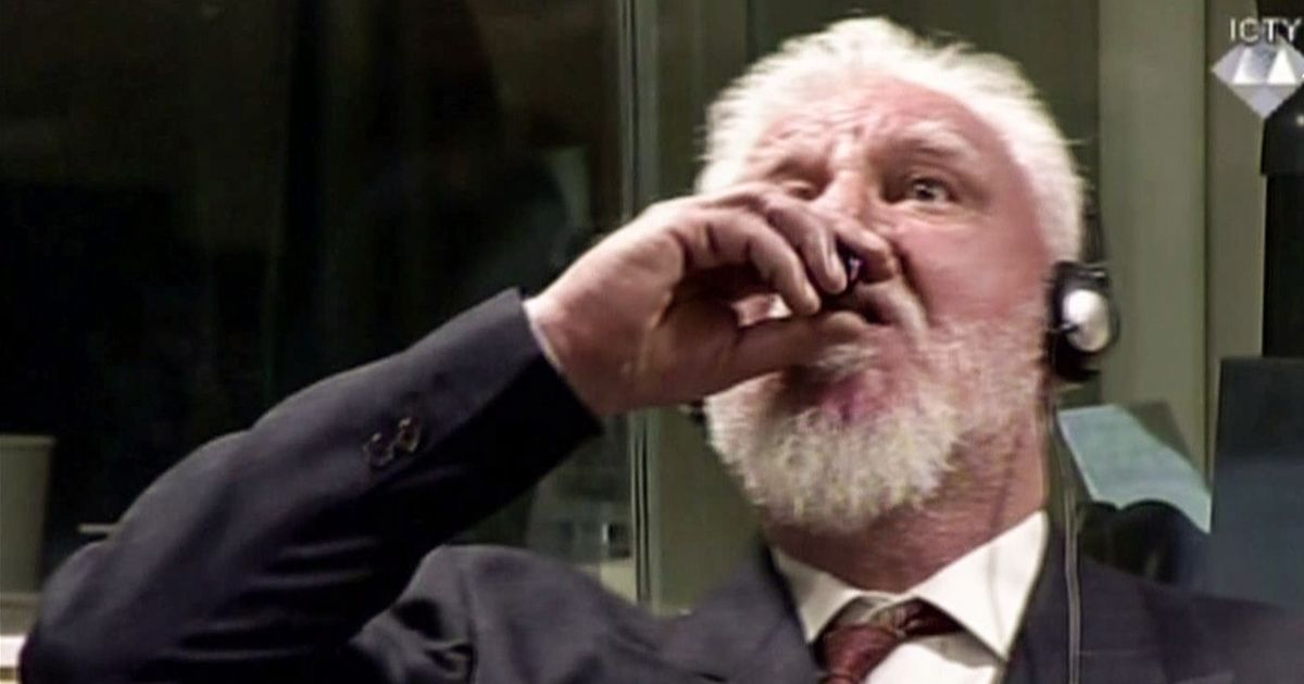 Former Bosnian Croat Army general convicted of war crimes dies after drinking poison in court