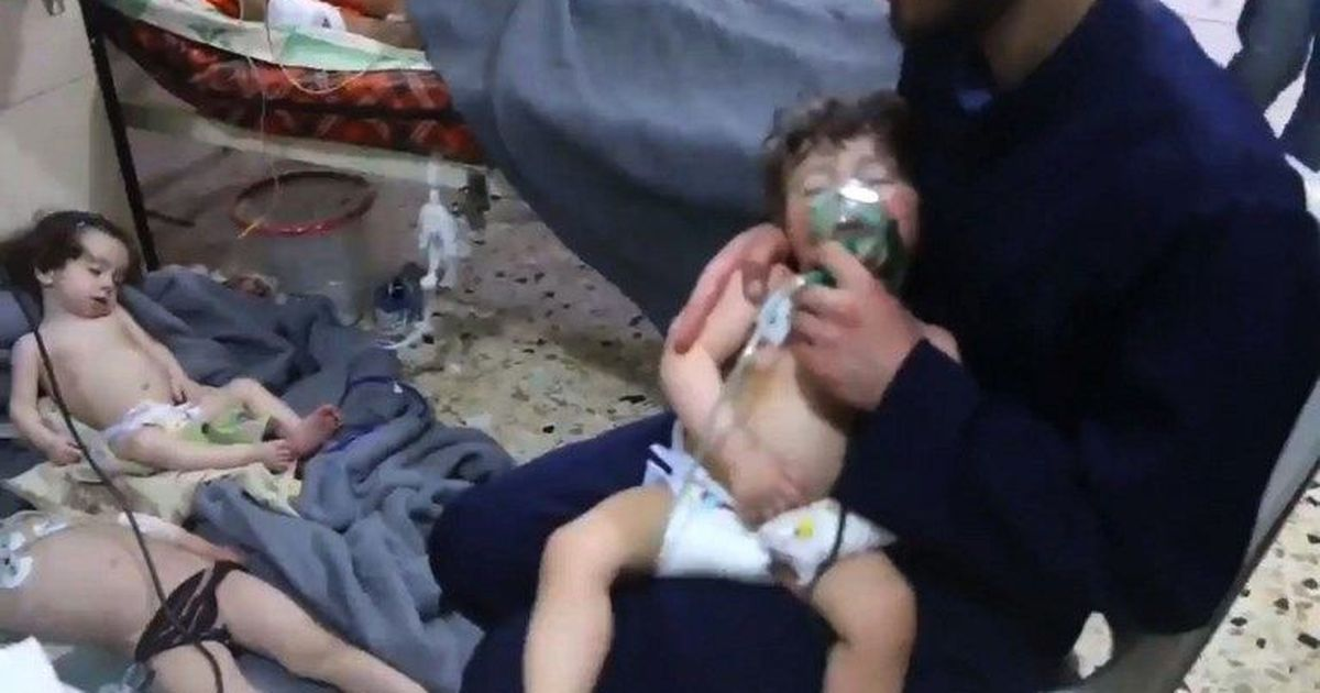 Syria and Russia deny use of chemical weapons in rebel-held town, as rescue workers peg toll at 70
