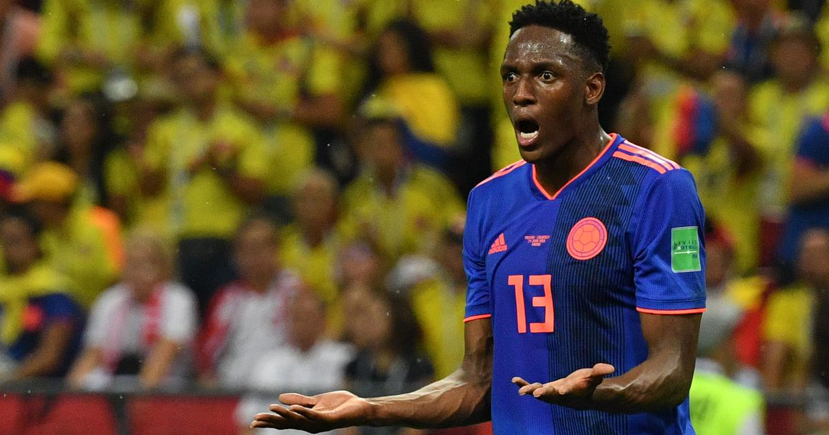 World Cup: Yerry Mina takes Colombia top of Group G, Senegal knocked out on fair-play record