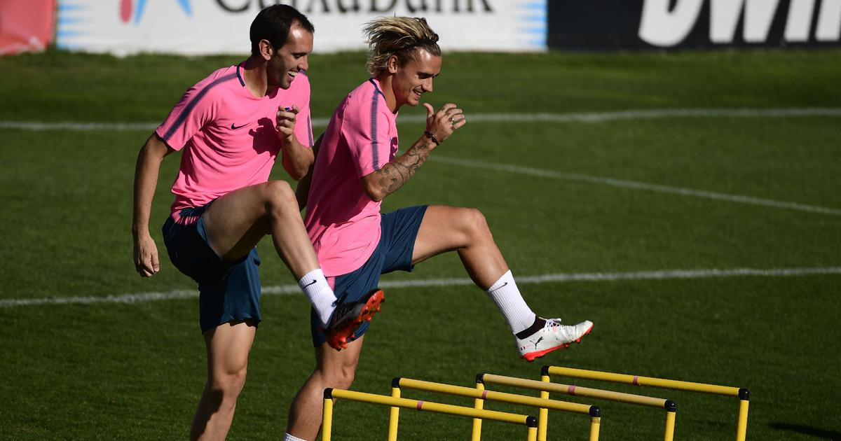 Friends turn rivals when Atletico Madrid teammates Griezmann and Godin face off in France vs Uruguay