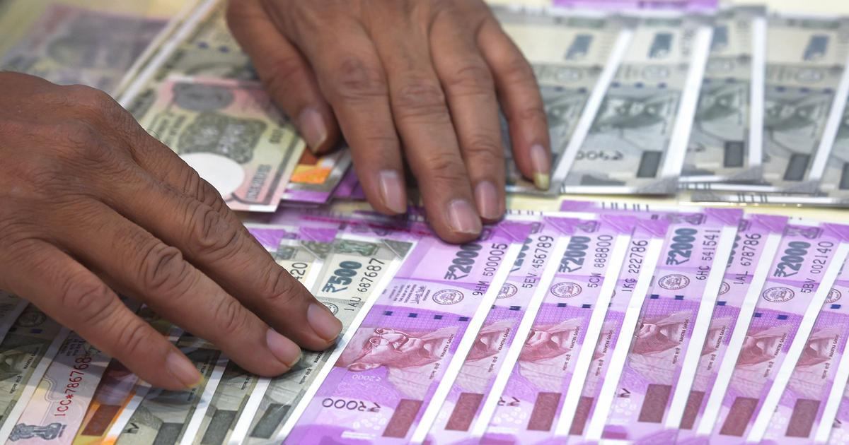 Rupee closes at 71 against the dollar for the first time