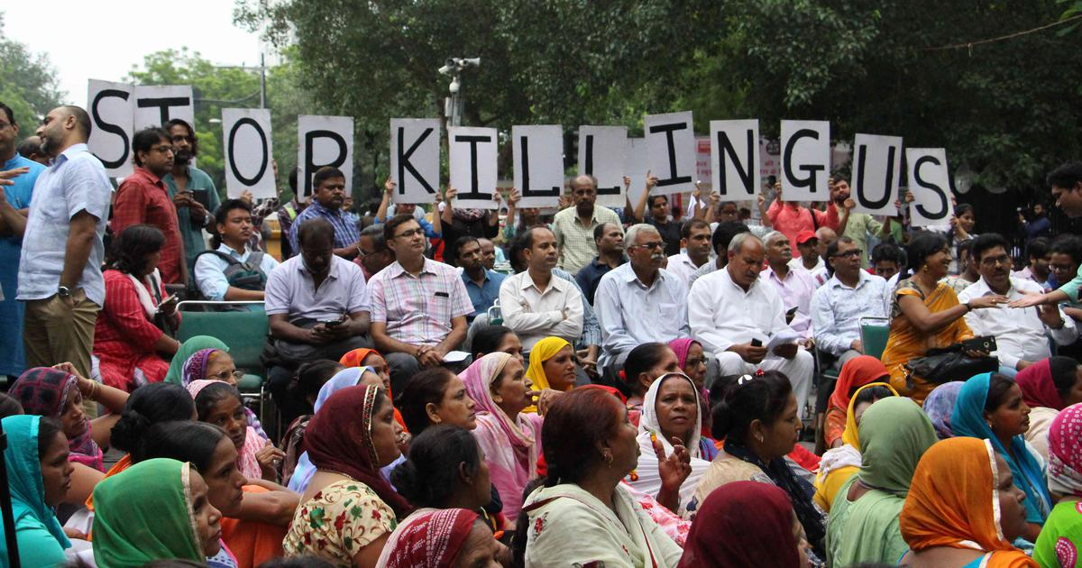 'National shame': Sewer workers, activists protest against deaths of manual scavengers in India