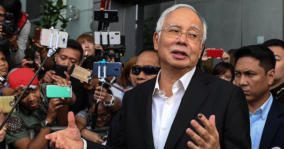 Former Malaysian PM and ex-treasury chief charged with criminal breach of trust in corruption case