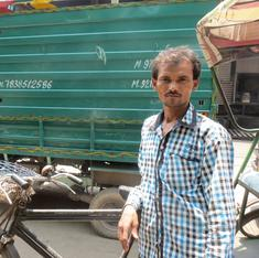 A Delhi cycle rickshaw wallah battles both heat and competition from machines