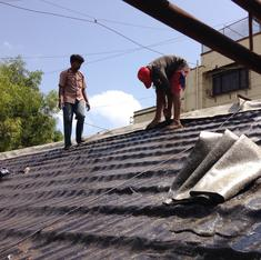 For workers tarring Mumbai's roofs, summer is both the best time and the worst time