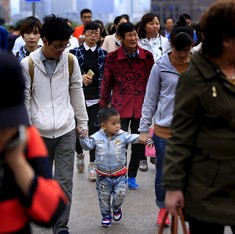 China promises rights to 13 million unregistered citizens